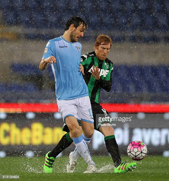 Davide Biondini of US Sassuolo competes for the ball with Marco Parolo of SS Lazio during the Serie A match between SS Lazio and US Sassuolo Calcio...
