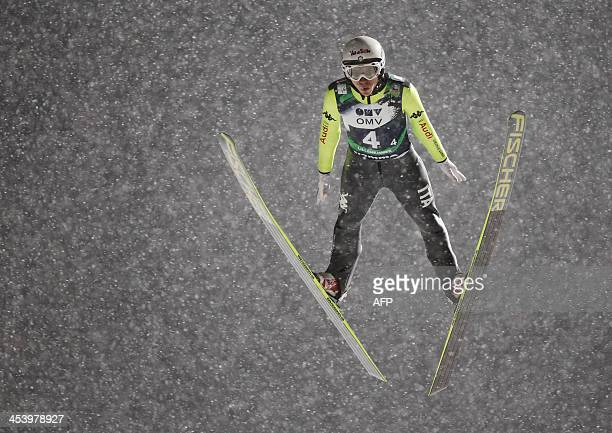 Davide Bresadola of Italia competes during the FIS World Cup ski jumping mixed team competition in Lillehammer Norway on December 6 2013 AFP PHOTO /...