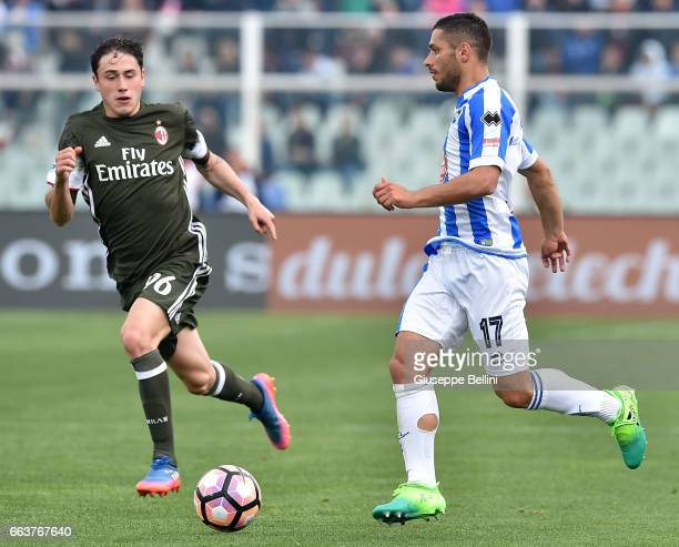 Davide Calabria of AC Milan and Gianluca Caprari of Pescara Calcio in action during the Serie A match between Pescara Calcio and AC Milan at...