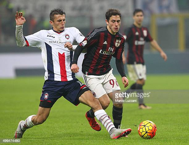 Davide Calabria of AC Milan competes for the ball with Ante Budimir of FC Crotone during the TIM Cup match between AC Milan and FC Crotone at Stadio...