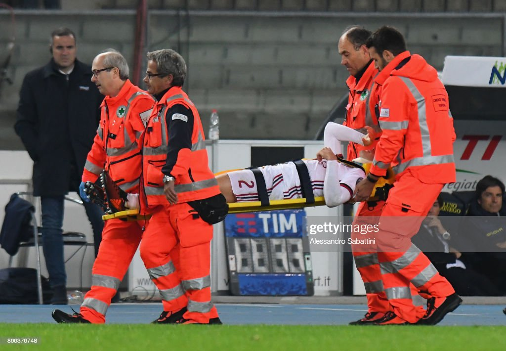 Davide Calabria of AC Milan is carried off injured during the Serie A match between AC Chievo Verona and AC Milan at Stadio Marc'Antonio Bentegodi on October 25, 2017 in Verona, Italy.