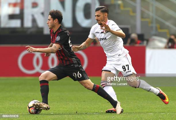 Davide Calabria of AC Milan is challenged by Giuseppe Pezzella of US Citta di Palermo during the Serie A match between AC Milan and US Citta di...