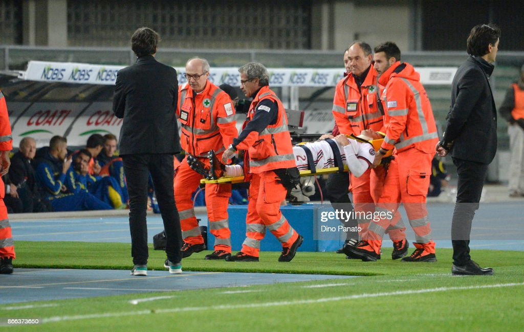 Davide Calabria of AC Milan lies injured on the pitch during the Serie A match between AC Chievo Verona and AC Milan at Stadio Marc'Antonio Bentegodi on October 25, 2017 in Verona, Italy.