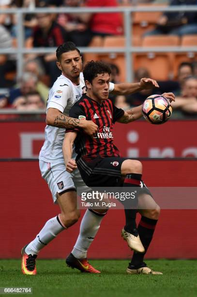 Davide Calabria of Milan is challenged by Giuseppe Pezzella of Palermo during the Serie A match between AC Milan and US Citta di Palermo at Stadio...