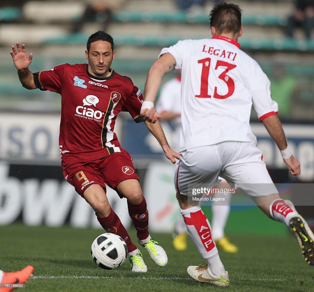 Davide Di Michele of Reggina is challenged by Elia Legati of Padova during the Serie B match between Reggina Calcio and Calcio Padova on February 16, 2013 in Reggio Calabria, Italy.
