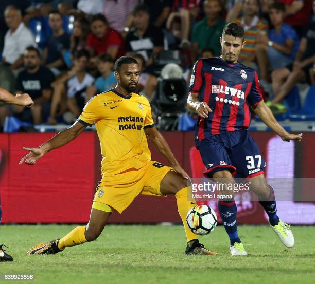 Davide Faraoni of Crotone competes for the ball with Samuel Suprayen of Verona during the Serie A match between FC Crotone and Hellas Verona FC at...