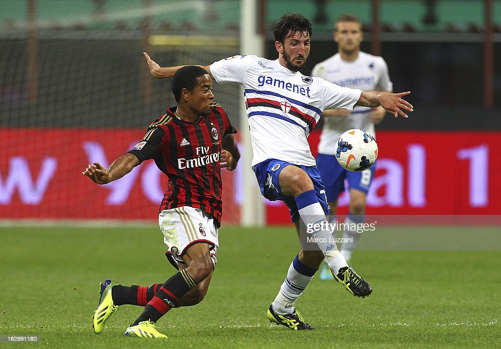 Davide Gavazzi of UC Sampdoria (R) and <a gi-track='captionPersonalityLinkClicked' href=/galleries/search?phrase=Urby+Emanuelson&family=editorial&specificpeople=594399 ng-click='$event.stopPropagation()'>Urby Emanuelson</a> of AC Milan compete for the ball with during the Serie A match between AC Milan and UC Sampdoria at Stadio Giuseppe Meazza on September 28, 2013 in Milan, Italy.