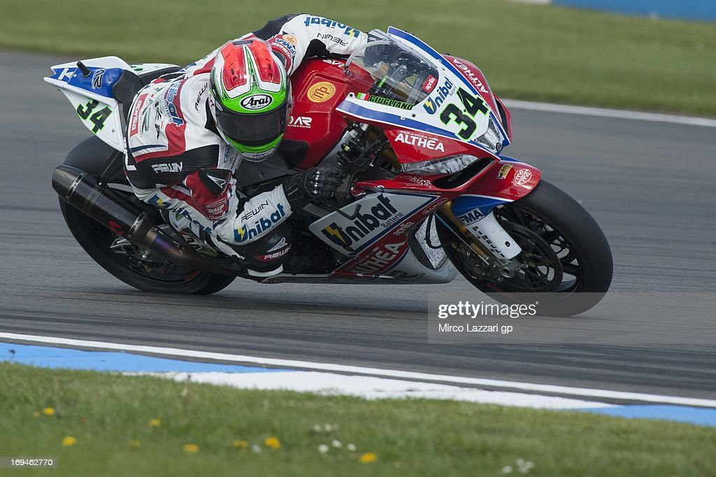 Davide Giugliano of Italy and Althea Racing rounds the bend during the World Superbikes - Qualifying during the round five of 2013 Superbikes FIM World Championship at Donington Park on May 25, 2013 in Castle Donington, England.