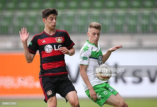 Davide Itter of Wolfsburg vies with Kai Havertz of Leverkusen during the U17 German Championship Semi Final Second Leg between VfL Wolfsburg U17 and...