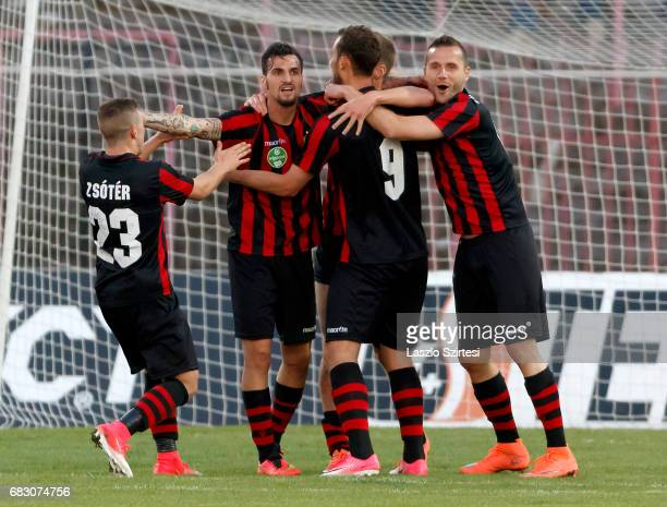 Davide Lanzafame of Budapest Honved celebrates the winning goal with Donat Zsoter of Budapest Honved Marton Eppel of Budapest Honved and Dusan...