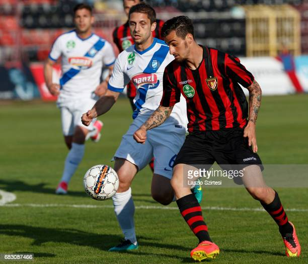 Davide Lanzafame of Budapest Honved competes for the ball with Drazen Okuka of MTK Budapest during the Hungarian OTP Bank Liga match between Budapest...