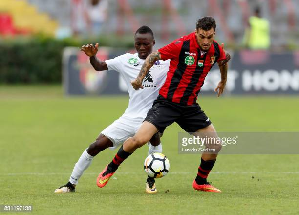 Davide Lanzafame of Budapest Honved competes for the ball with Obinna Nwobodo of Ujpest FC during the Hungarian OTP Bank Liga match between Budapest...