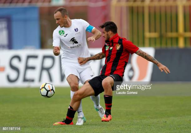 Davide Lanzafame of Budapest Honved competes for the ball with Robert Litauszki of Ujpest FC during the Hungarian OTP Bank Liga match between...