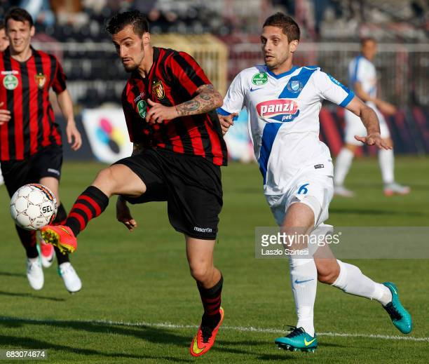 Davide Lanzafame of Budapest Honved wins the ball from Drazen Okuka of MTK Budapest during the Hungarian OTP Bank Liga match between Budapest Honved...