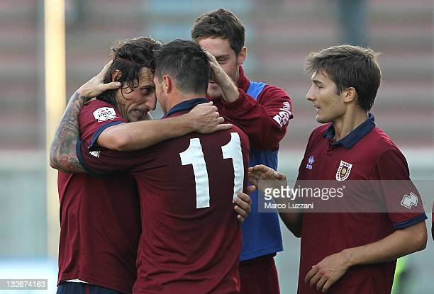 Davide Matteini of AC Reggiana celebrates with his teammates Mario Guarma and Matteo Arati after scoring his goal during the Lega Pro match between...