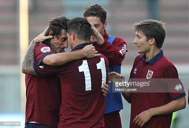 Davide Matteini of AC Reggiana celebrates with his teammates Mario Guarma and Matteo Arati after scoring his goal during the Lega Pro match between...