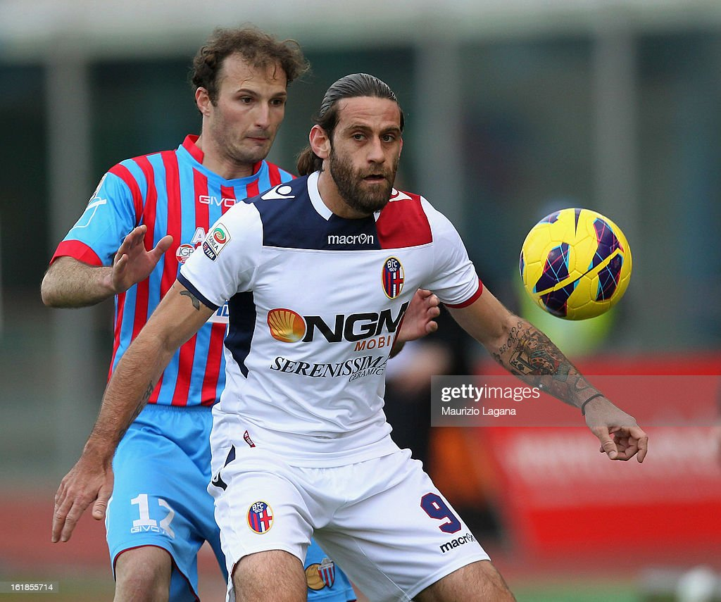 Davide Moscardelli of Bologna (R) and Giovanni Marchese of Catania in action during the Serie A match between Calcio Catania and Bologna FC at Stadio Angelo Massimino on February 17, 2013 in Catania, Italy.