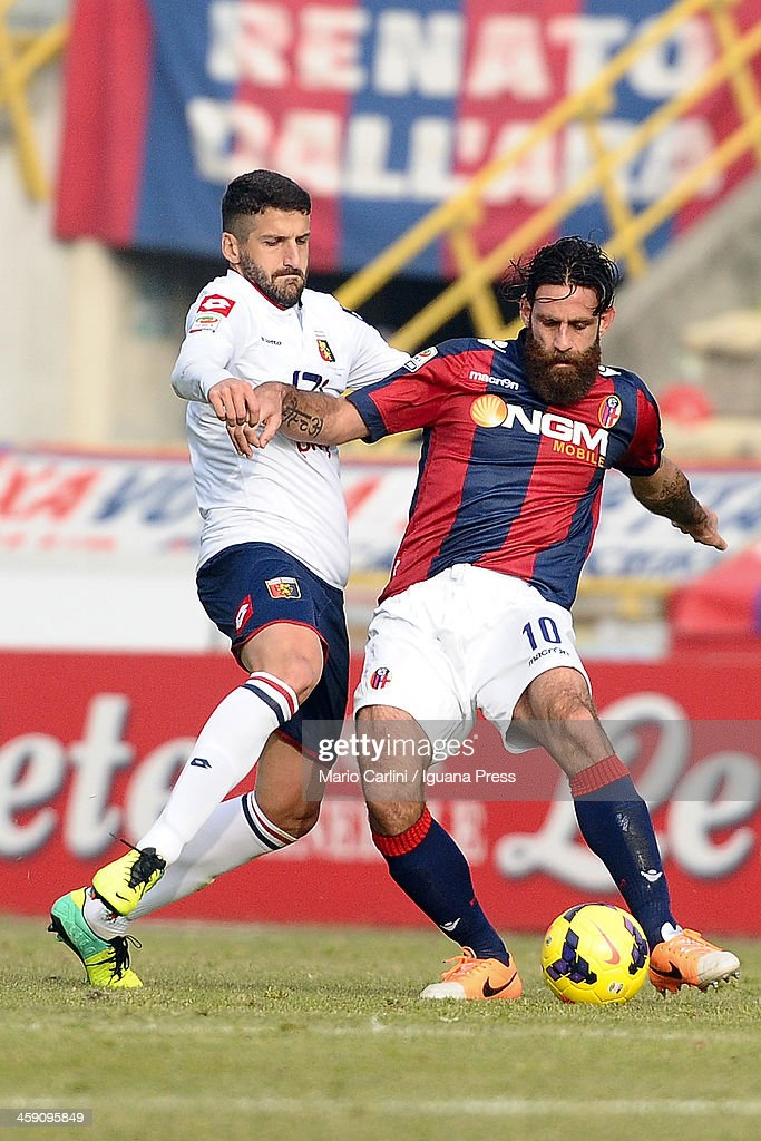 Davide Moscardelli # 10 of Bologna FC (R) competes for the ball with <a gi-track='captionPersonalityLinkClicked' href=/galleries/search?phrase=Alessandro+Gamberini&family=editorial&specificpeople=695639 ng-click='$event.stopPropagation()'>Alessandro Gamberini</a> # 5 of CFC Genoa (L) during the Serie A match between Bologna FC and Genoa CFC at Stadio Renato Dall'Ara on December 22, 2013 in Bologna, Italy.