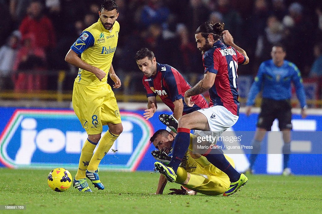 Davide Moscardelli # 10 of Bologna FC ( R ) competes the ball with <a gi-track='captionPersonalityLinkClicked' href=/galleries/search?phrase=Dario+Dainelli&family=editorial&specificpeople=179389 ng-click='$event.stopPropagation()'>Dario Dainelli</a> # 3 of AC Chievo Verona ( L ) during the Serie A match between Bologna FC and AC Chievo Verona at Stadio Renato Dall'Ara on November 4, 2013 in Bologna, Italy.