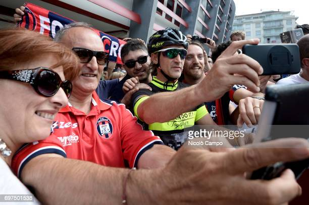 Davide Nicola poses for a photo with supporters as he arrives at the Filadelfia Stadium in Turin on a bicycle Davide Nicola is the head coach of FC...