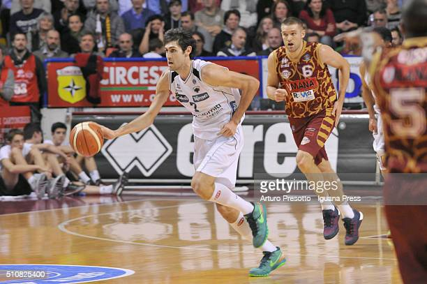 Davide Pascolo of Dolomiti Energia competes with Michael Bramos of Umana during the LegaBasket match between Reyer Umana Venezia and Aquila Dolomiti...