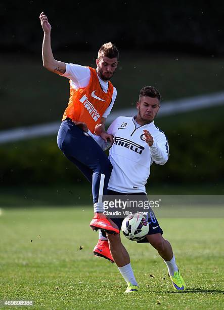 Davide Santon and George Puscas compete for the ball during FC Internazionale training session at the club's training ground at Appiano Gentile on...