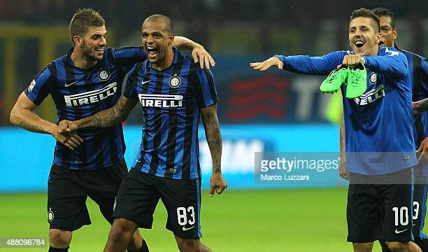 Davide Santon Felipe Melo and Stevan Jovetic celebrate a victory at the end of the Serie A match between FC Internazionale Milano and AC Milan at...