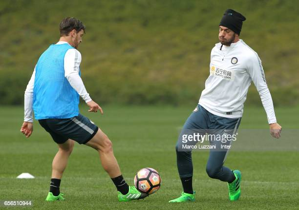 Davide Santon is challenged by Cristian Ansaldi during the FC Internazionale training session at the club's training ground Suning Training Center in...