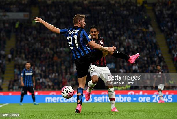 Davide Santon of FC Internazionale and Carlos Bacca of AC Milan compete for the ball during the Serie A match between FC Internazionale Milano and AC...