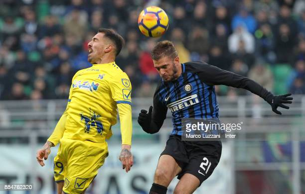 Davide Santon of FC Internazionale competes for the ball with Fabrizio Cacciatore of AC Chievo Verona during the Serie A match between FC...