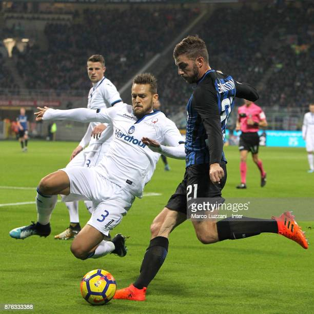 Davide Santon of FC Internazionale competes for the ball with Rafael Toloi of Atalanta BC during the Serie A match between FC Internazionale and...