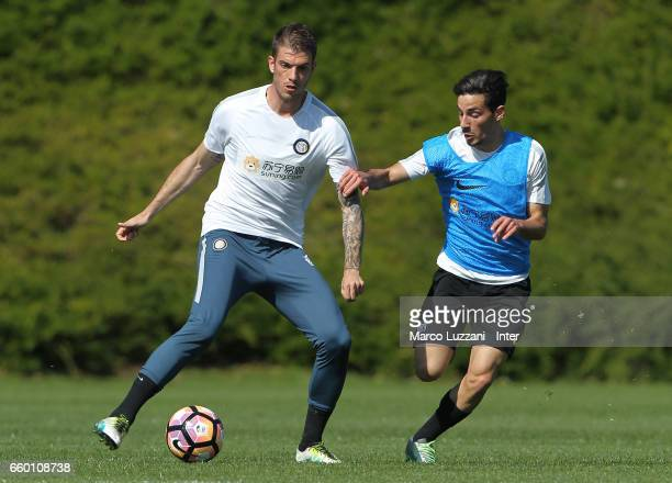 Davide Santon of FC Internazionale is challenged during the FC Internazionale training session at the club's training ground Suning Training Center...