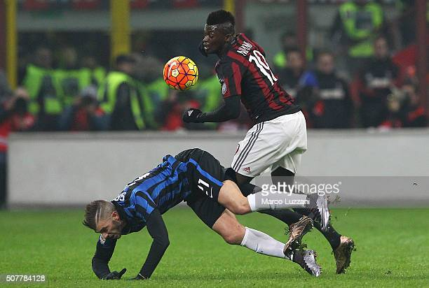 Davide Santon of FC Internazionale Milano competes for the ball with M Baye Niang of AC Milan during the Serie A match between AC Milan and FC...