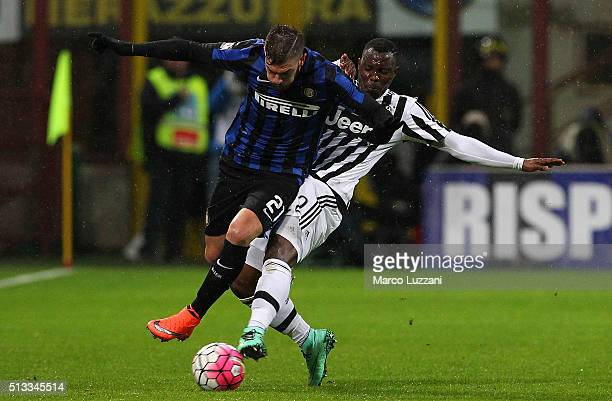 Davide Santon of FC Internazionale Milano competes for the ball with Kwadwo Asamoah of Juventus FC during the TIM Cup match between FC Internazionale...