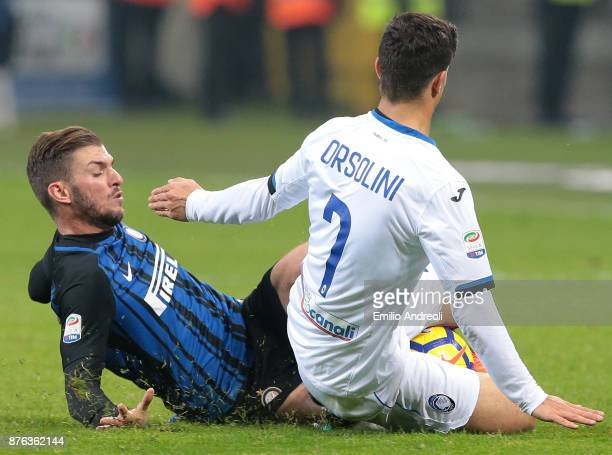 Davide Santon of FC Internazionale Milano competes for the ball with Riccardo Orsolini of Atalanta BC during the Serie A match between FC...