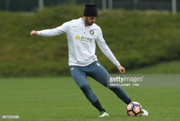 Davide Santon of FC Internazionale Milano kicks a ball during the FC Internazionale training session at the club's training ground Suning Training...