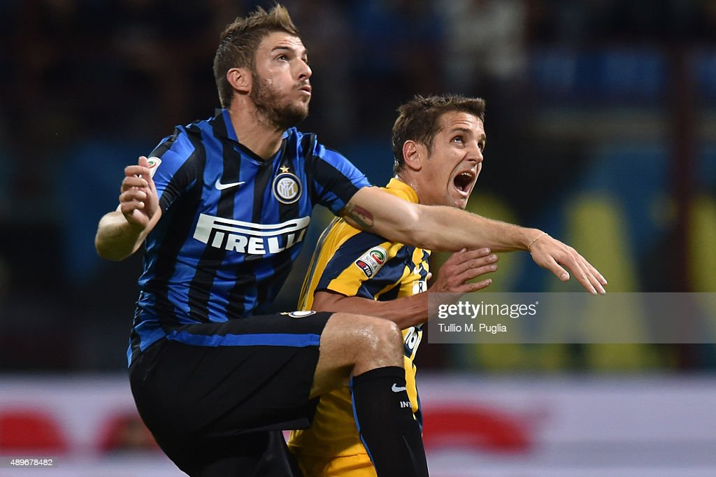 Davide Santon of Internazionale Milano and Juan Gomez of Hellas Verona compete for the ball during the Serie A match between FC Internazionale Milano...