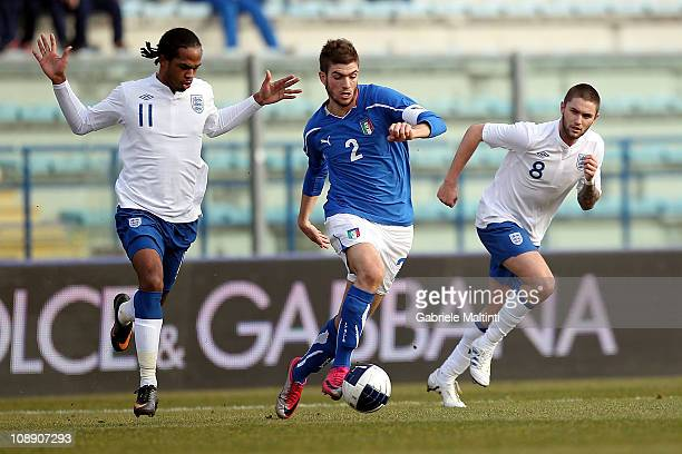 Davide Santon of Italy fights for the ball with Nathan Delfouneso and Henri Lansbury of England during the international friendly match between Italy...