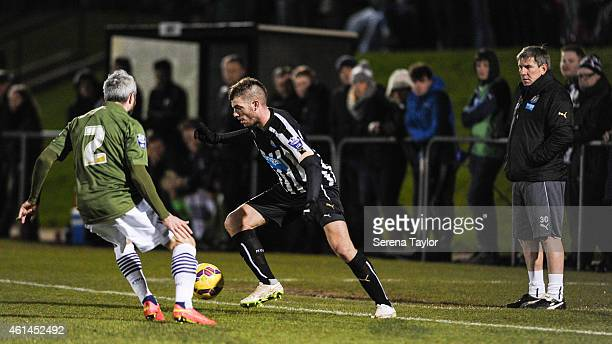 Davide Santon of Newcastle controls the ball whilst being pursued by Kevin McNaughton of Bolton as Newcastle's Football Development Manager Peter...