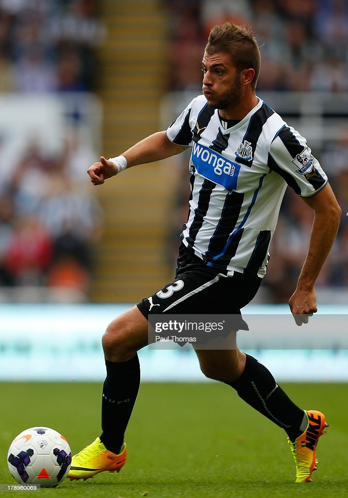 Davide Santon of Newcastle in action during the Premier League match between Newcastle United and Fulham at the St James Park on August 31 2013 in...