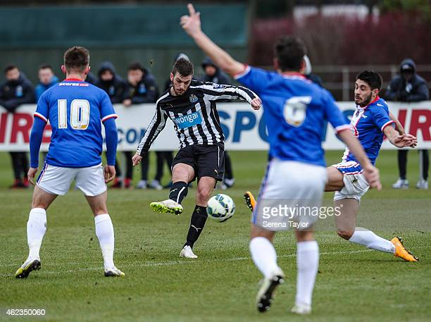 Davide Santon of Newcastle strikes the ball during a friendly match between Newcastle United and Carlisle United at The Newcastle United Training...