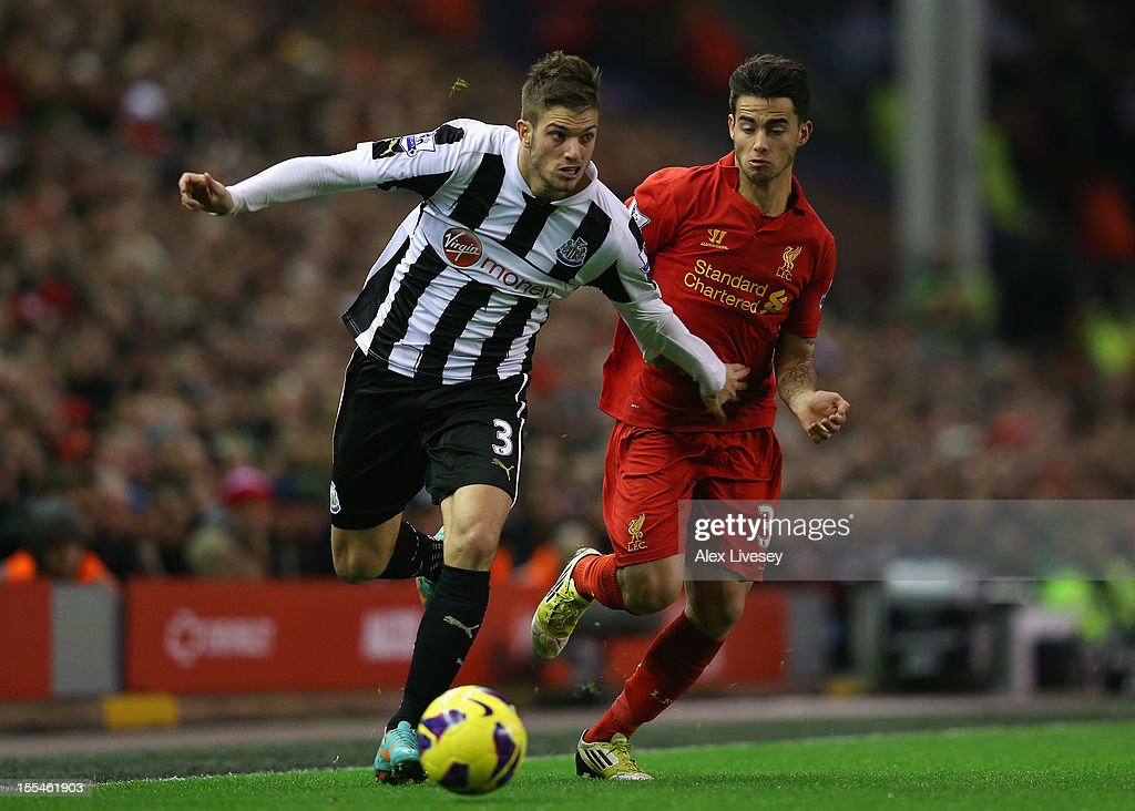 Davide Santon of Newcastle United competes with Suso of Liverpool during the Barclays Premier League match between Liverpool and Newcastle United at Anfield on November 4, 2012 in Liverpool, England.