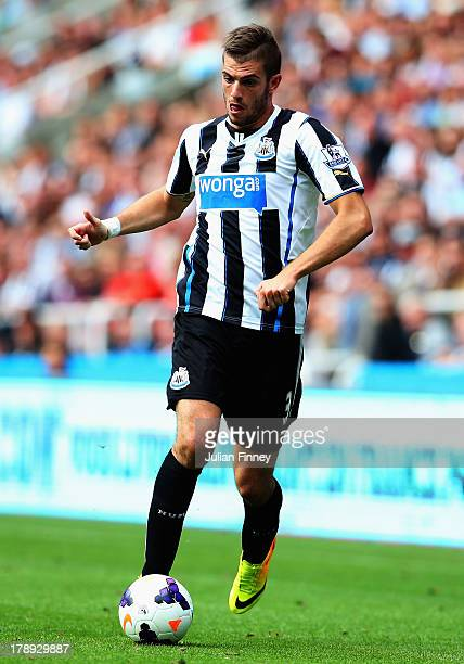 Davide Santon of Newcastle United runs with the ball during the Barclays Premier League match between Newcastle United and Fulham at St James' Park...