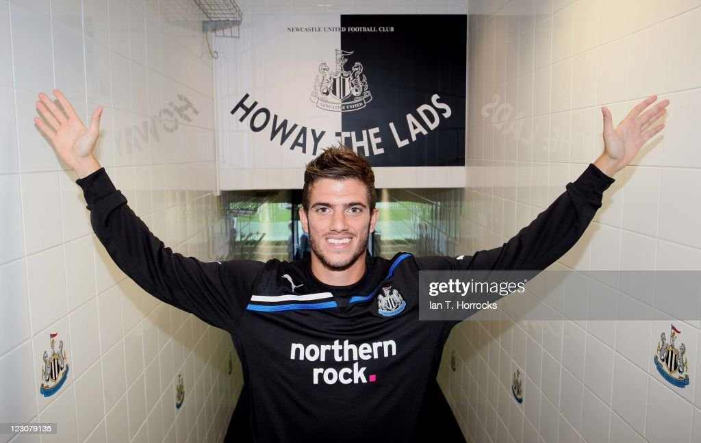 <a gi-track='captionPersonalityLinkClicked' href=/galleries/search?phrase=Davide+Santon&family=editorial&specificpeople=5679382 ng-click='$event.stopPropagation()'>Davide Santon</a> poses after signing for Newcastle United from Inter Milan at St James' Park on August 30, 2011 in Newcastle, United Kingdom.