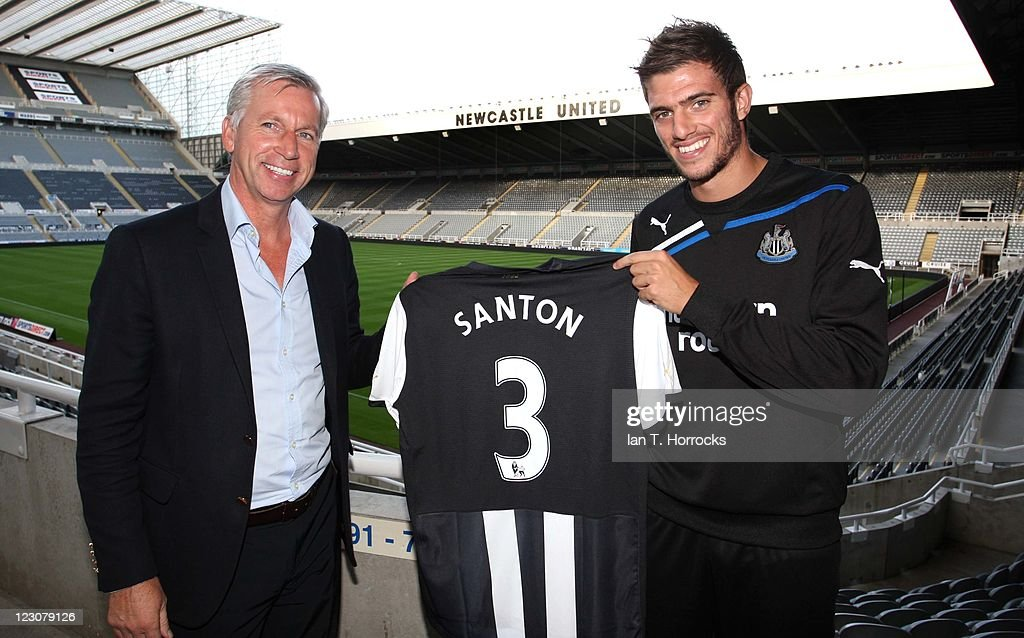 Davide Santon poses with manager Alan Pardew after signing for Newcastle United from Inter Milan at St James' Park on August 30 2011 in Newcastle...