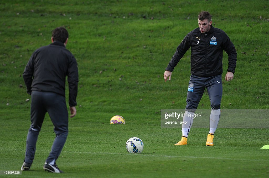 Davide Santon warms up with Physiotherapist Michael Harding during a training session at The Newcastle United Training Centre on October 30 in...