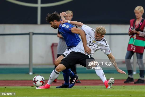 Davide Simoncini of San Marino and Julian Brandt of Germany battle for the ball during the FIFA 2018 World Cup Qualifier between Germany and San...