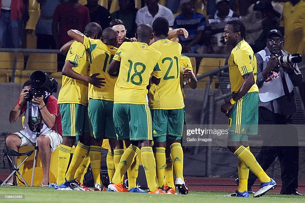 Davide Somma of South Africa celebrates scoring a goal with teammates during the International friendly match between South Africa and Kenya at Royal Bafokeng Stadium on February 09, 2011 in Rustenburg, South Africa.