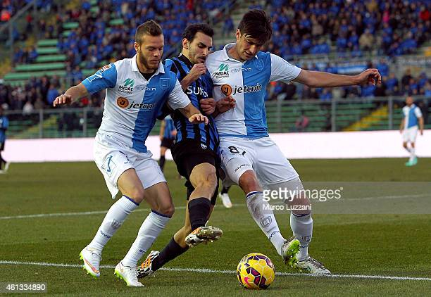 Davide Zappacosta of Atalanta BC competes for the ball with Ervin Zukanovic and Dejan Lazarevic of AC Chievo Verona during the Serie A match between...