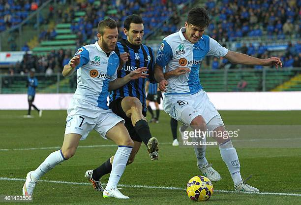 Davide Zappacosta of Atalanta BC competes for the ball with Ervin Zukanovic and Dejan Lazarevic of AC Chievo Verona during the Serire A match between...